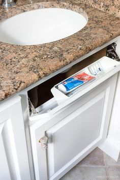 "Painted Bathroom Vanity: The ""Before"" & ""After"" and How-to Guide! Love this little caddy for a toothbrush and toothpaste in this bathroom vanity!Love this little caddy for a toothbrush and toothpaste in this bathroom vanity! Bathroom Vanity Organization, Bathroom Vanity Tops, Bathroom Wallpaper, Bathroom Ideas, Paint Brushes And Rollers, Best Neutral Paint Colors, Painted Vanity, Granite Vanity Tops, Driven By Decor"