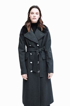 Model Leila wears a double-breasted trench in weather-ready wool, from Calvin Klein