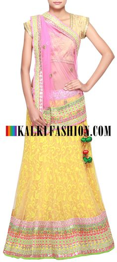 Buy Online from the link below. We ship worldwide (Free Shipping over US$100) http://www.kalkifashion.com/yellow-lehenga-enhanced-in-thread-and-border-embroidery-only-on-kalki.html