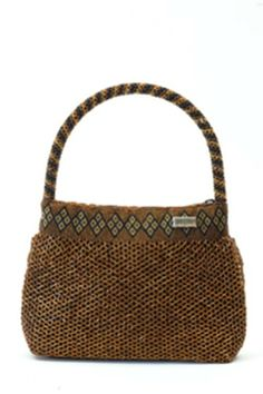 Each Bindah consists of a hand woven basket made of the ata vine and detailed with hand sewn glass beads.
