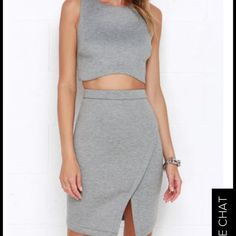 """2 piece skirt and crop top never worn . Pieces are interchangeable ! 2 for 1 Medium-weight padded scuba knit has a soft feel across the sleeveless and darted crop top with crisscrossing panels at back. The sexy high-rise skirt adds plenty of shape while curving to an envelope front with slit. Top has hidden side zipper; skirt has hidden back zipper with clasp. Fully lined. Small top measures 14.5"""" long. Small bottom measures 19"""" long. Self: 78% Polyester, 15% Viscose, 7% Spandex. Lining…"""
