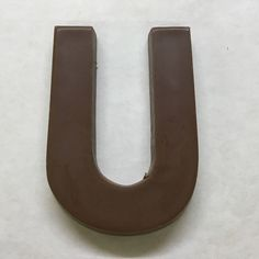 The letter U made of milk chocolate. Candy Letters, Chocolate Letters, Milk, Lettering, Products, Drawing Letters, Gadget, Brush Lettering