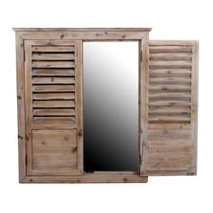 Pair old shutters, antiqued mirror insert, set above landlocked sink.  Art? Fake Window? Reflective surface for brighter space? Smile encourager?