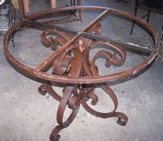 wrought iron table bases in frisco, texas. Would live to find a base like this and having a granite top.