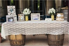 Love this idea! Instead of a cheesy slideshow get some cute frames and pick a few great pictures! | Country Chic Wedding by Kimberly Carlson Photography