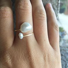 Sea Cove Designs www.seacovedesigns.com Raw gemstone jewelry handmade in Santa Barbara, California. This elegant and beachy statement ring features a non-tarnish hammered gold band capped with a large, genuine baroque pearl and a smaller genuine potato pearl. The ring is not closed and