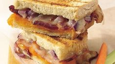 Grilled cheese sandwiches--actually cooked on the grill--taste smoky good and extra rich with added bacon and two kinds of cheese.