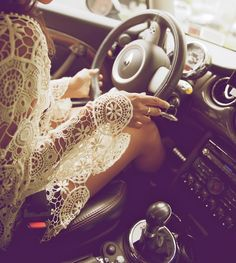 Behind the wheel in all over lace.