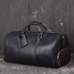 Vintage Full Grain Leather Travel Bag, Large Duffle Bag, Overnight Bags Model Number: Dimensions: x x / 50 cm(L) x 23 cm(W) x 26 cm(H) Weight: lb / kg Hardware: Brass Hardware Shoulder Strap: Adjustable & Removable Color: Dark Brown / Black Features: Leather Duffle Bag, Leather Satchel, Leather Luggage, Leather Bags, Leather Clutch, Duffle Bag Travel, Duffle Bags, Travel Bags, Messenger Bags