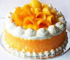 Mango Party Cake Brush layers of cake with simple sugar syrup. Added mashed sweet mangoes to buttercream filling Covered the cake with whipped cream, mango slices which I piled on top of the cake, brushed with simple syrup of apricot jam glaze.