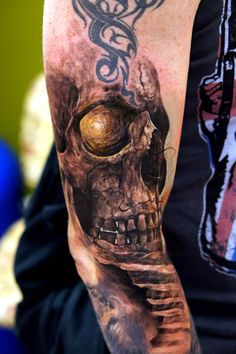 Excellent gold eye skull piece by Domantas Parvainis  #tattoos #tattoo #ink #art #hookedontattoos