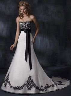 Gothic wedding dress- simple, with black ribbon and floral lace in black. Fabric dress, with chiffon, strapless- elegance.
