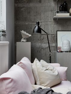 Living room with pink and concrete - via Coco Lapine Design blog