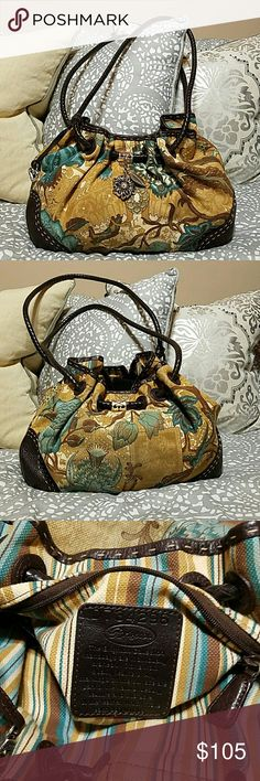 Brighton Handbag, style number D734296 Very fun, potentially reversible handbag. Love this bag and have taken very good care of it. It is in extremely good condition. The perfect bag to add some color or a funky print. Brighton Bags Hobos