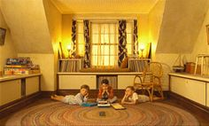 The childrens attic playroom in Moonrise Kingdom features a rag rug, vintage fabric curtains and a color palette straight out of the 50s. (Focus Features)