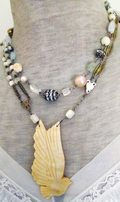 peace - vintage assemblage necklace with mother of pearl dove and rosary, pearls and gemstones by the french circus. via Etsy.