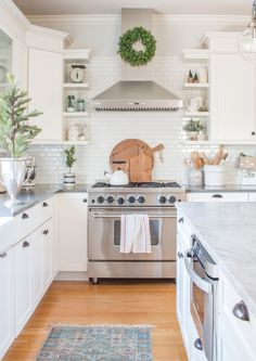 Tour a light and bright modern farmhouse kitchen decorated for Christmas. Simple touches of green and white create a simple and festive holiday space.