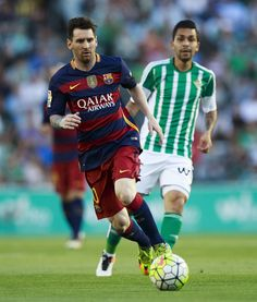 Lionel Messi (L) of FC Barcelona competes for the ball with Petros Matheus (R) of Real Betis Balompie during the La Liga match between Real Betis Balompie and FC Barcelona at Estadio Benito Villamarin on April 30, 2016 in Seville