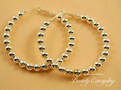 Sterling Silver Ball Hoop earrings! These earrings are great for everyday use and are very light!
