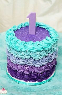 Purple and teal first birthday cake