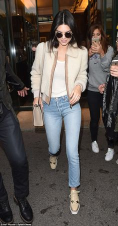Accessory swap: Kendall later emerged wearing a smart leather satchel over one shoulder in a coordinating shade of beige