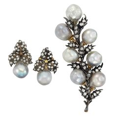 Silver, Gold, Semi-Baroque Gray Cultured Pearl and Diamond Clip-Brooch and Pair of Earclips, Buccellati  The brooch centering a line of diamond-set leaves edged by 7 pearls approximately 10.8 to 9.6 mm., the earclips topped by a cluster of diamond-set leaves, supporting 2 pearls approximately 10.0 and 10.5 mm., set throughout with rose-cut diamonds, signed Buccellati.