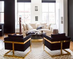 Chic living room with black and gold armchairs