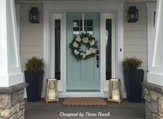 wooden front door, greige siding, blue pots - Google Search
