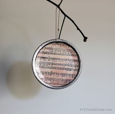 Think I'll add these to my burlap garland and white light Christmas tree this year : ) DIY Mason Jar Lid Ornaments - DIY on the Cheap Music Christmas Ornaments, Burlap Christmas Tree, Christmas Fun, Diy Ornaments, Sheet Music Ornaments Diy, Ornament Tree, Handmade Christmas, Mason Jar Lids, Mason Jar Crafts