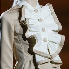 Marc Jacobs designed a modern version of a Jabot for his women's fashion collection. Obviously it lacks ruffles, but the peats give it the overall look of an 18th century idea. Jabot - Frill attached to front of ones shirt popping out at the neckline of the waistcoat