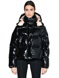 MONCLER - GAURA VYNIL DOWN JACKET - DOWN JACKETS - BLACK - LUISAVIAROMA - Detachable hood with snap buttons. Front snap button and two-way zip closure . Elastic cuffs with snap buttons. Logo detail on sleeve. Two side zip pockets . Down feather filling . Wool collar and placket lining . Contrasting color Technique nylon lining . Sample size: 1