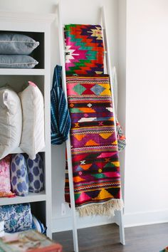 Use a ladder to display blankets