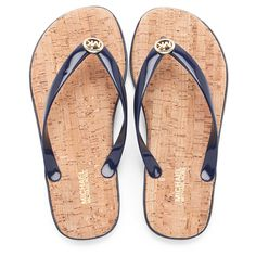 6189f0e5645be Women s navy  Jet Set MK  sandals with jelly toe thong uppers from MICHAEL  MICHAEL KORS. The flip flops feature an absorbent cork footbed that  cushions the ...