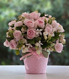 Pink arrangement with David Austin roses and freesias