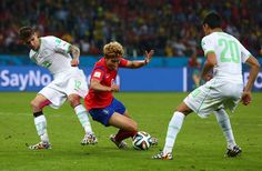 Carl Medjani Photos - Son Heung-Min of South Korea competes for the ball with Carl Medjani of Algeria during the 2014 FIFA World Cup Brazil Group H match between South Korea and Algeria at Estadio Beira-Rio on June 22, 2014 in Porto Alegre, Brazil. - Korea Republic v Algeria: Group H - 2014 FIFA World Cup Brazil