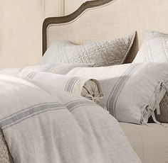 This bedding is from Restoration Hardware as mentioned in this blog. Blog has a tutorial on how to get the look of this fabric using paint and fabric medium.