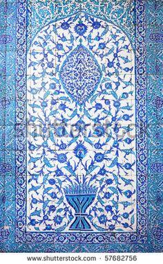 Traditional Oriental Art / Close-up photo of handmade Turkish tiles, Istanbul, Turkey by Taiga, via ShutterStock
