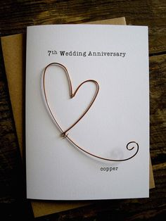 Understated and elegant. Handmade greetings card for 7 years.  7th Wedding Anniversary incorporating COPPER  A handworked copper metal wire heart.