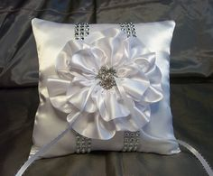 White Satin Ring Bearer Pillow embellished with a White Flower