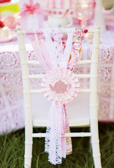 Back Decor: Ripped fabric with a pink polka dot paper rosette, doily & sparkly teacup!