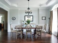 Sherwin Williams Silver Strand : Less-Than-Perfect Life of Bliss found great deals on their dining chairs. The upholstered chairs are from Ross (I know, great score!) and the wooden chairs were on sale at Restoration Hardware. The soft gray walls are Sherwin Williams Silver Strand.
