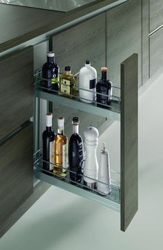 Love this for spices and cooking oils... One for each side of the range?(Modern Kitchen Cabinets in NYC)