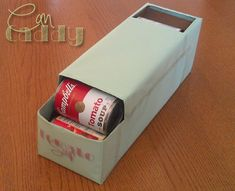 Make your own can caddy from an old soda box!!!! Look out pantry... your mess does not stand a chance now!