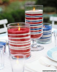 Patriotic Summer Centerpieces - Layer red, white and blue sand in clear glasses almost to the rim and place a votive on top.