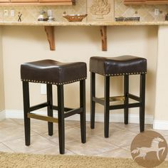 These comfortably soft, bonded leather barstools are a perfect transitional piece from your kitchen to your living room. Bronze-colored studs are featured along the edges of the seat and the copper kickplate gives this stool a contemporary look.