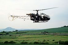 A Bundesgrenzschutz Alouette II helicopter patrols the West German side of the inner German border, East German border guards are in the background. Stol Aircraft, Sud Aviation, Border Guard, Staff Sergeant, Military Helicopter, Wallpaper Backgrounds, Wallpapers, World War Ii, Background Images