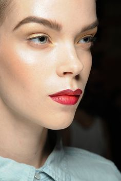 """Red Lips Jason Wu  lips a perfect shade of cherry red, hair slicked into a masculine/feminine quiff. """"It's Helmut Newton,"""""""