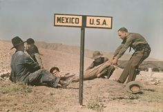 Two border-patrol officers attempt to keep a fugitive in the U.S.  Luis Marden/National Geographic.