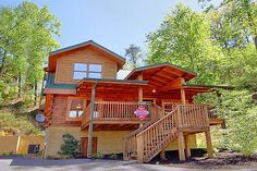 Campbells Cabin rental in Pigeon Forge, TN. This gorgeous cabin is close to all of the attractions. It features two beautiful king suites, each with a Jacuzzi and TV. After a day's excitement relax in the spacious hot tub or gather around the fireplace and watch a family movie. Challenge family members to a friendly game of pool on the pool table or enjoy the arcade game. Campbell's Cabin is luxury at its best and offers all the amenities needed for a memorable Smoky Mountain vacation.