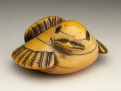Japan  Plover, late 18th century  Netsuke, Ivory with staining, sumi, inlays. LACMA
